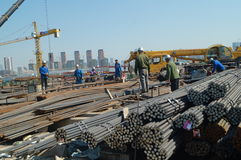 Shenzhen, China: Construction workers in handling steel Royalty Free Stock Image