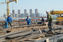 Shenzhen, China: Construction workers in handling steel Stock Photo