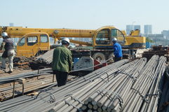 Shenzhen, China: Construction workers in handling steel Stock Images