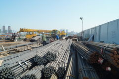 Shenzhen, China: Construction workers in handling steel Royalty Free Stock Images
