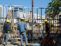 Shenzhen, China: construction workers at construction sites. Royalty Free Stock Image