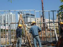 Shenzhen, China: construction workers at construction sites. Royalty Free Stock Photo