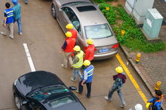 Shenzhen, China: construction workers walk home Royalty Free Stock Photo