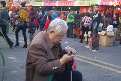 Shenzhen, china: dial mobile phone in the elderly Stock Image