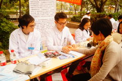 Shenzhen, China: doctors in public hospitals to the community for free medical treatment for residents. Baoan District people`s Hospital of experts and doctors royalty free stock photos