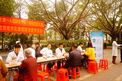 Shenzhen, China: doctors in public hospitals to the community for free medical treatment for residents. Baoan District people`s Hospital of experts and doctors royalty free stock photography