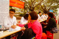 Shenzhen, China: doctors in public hospitals to the community for free medical treatment for residents. Baoan District people`s Hospital of experts and doctors stock photography