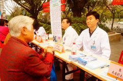 Shenzhen, China: doctors in public hospitals to the community for free medical treatment for residents. Baoan District people`s Hospital of experts and doctors royalty free stock images