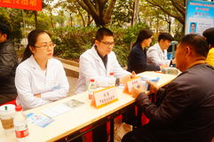 Shenzhen, China: doctors in public hospitals to the community for free medical treatment for residents. Baoan District people`s Hospital of experts and doctors stock image