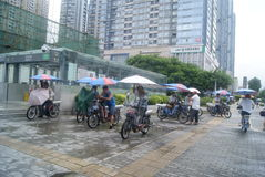 Shenzhen, China: electric bicycle soliciting subway station Royalty Free Stock Photography
