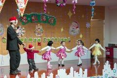 SHENZHEN, CHINA, 2011-12-23: European kindergarten teacher perfo Royalty Free Stock Images