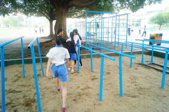 Shenzhen, China: female middle school students in the horizontal bar exercise Royalty Free Stock Images