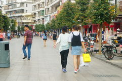 Shenzhen, China: female tourists in Xixiang commercial pedestrian street Stock Photography