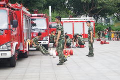 Shenzhen, China: Fire Fighter Training Stock Photo