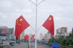 Shenzhen, China: five-star red flag flying the Baoan Avenue Stock Photo
