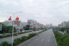 Shenzhen, China: five-star red flag flying the Baoan Avenue Royalty Free Stock Images