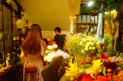 Shenzhen, China: flowers shop, young men are selling flowers. Flowers shop, young men are selling flowers. Many beautiful flowers Royalty Free Stock Photos