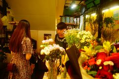 Shenzhen, China: flowers shop, young men are selling flowers. Flowers shop, young men are selling flowers. Many beautiful flowers Royalty Free Stock Photo