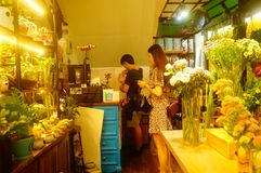 Shenzhen, China: flowers shop, young men are selling flowers. Flowers shop, young men are selling flowers. Many beautiful flowers Royalty Free Stock Image