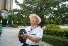 Shenzhen, China: flying kites elderly Stock Photo