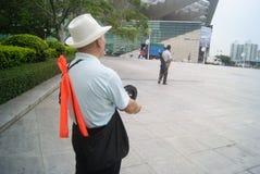 Shenzhen, China: flying kites elderly Stock Photos