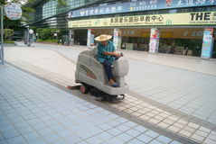 Shenzhen, China: garbage truck cleaning floor Royalty Free Stock Image