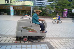 Shenzhen, China: garbage truck cleaning floor Royalty Free Stock Images