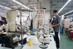 Shenzhen, China: garment factory workshop Royalty Free Stock Photos