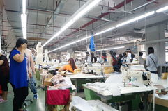 Shenzhen, China: garment factory workshop Royalty Free Stock Photography