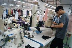Shenzhen, China: garment factory workshop Stock Photography
