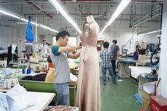Shenzhen, China: garment factory workshop Stock Image