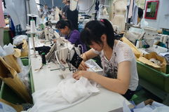 Shenzhen, China: garment factory workshop. Shenzhen Longhua District, Dalang street, garment factory workshop, the workers are making clothing royalty free stock photography