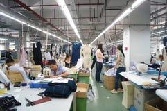 Shenzhen, China: garment factory workshop Royalty Free Stock Photo