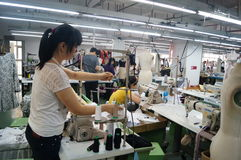 Shenzhen, China: garment factory workshop Stock Photos