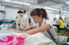 Shenzhen, China: garment factory workshop Stock Photo