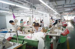 Shenzhen, China: garment factory workshop Royalty Free Stock Photography