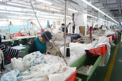 Shenzhen, China: garment factory workshop Stock Photography