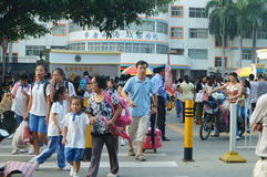 Shenzhen, China: the gate of the school gathered parents shuttle children Royalty Free Stock Images