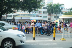 Shenzhen, China: the gate of the school gathered parents shuttle children Stock Image