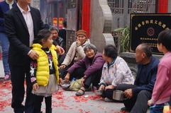 Shenzhen, China: in the gate of the temple are beggars Royalty Free Stock Photos