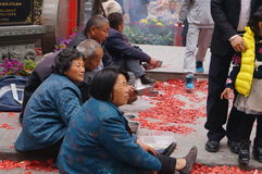 Shenzhen, China: in the gate of the temple are beggars Royalty Free Stock Photography