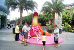 Shenzhen china: the giant lady shoes sculpture landscape Royalty Free Stock Photo