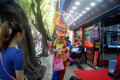 Shenzhen, China: gold jewelry sales promotion, play the clown Stock Photos