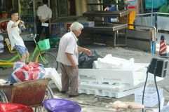 Shenzhen, China: grandma who is collecting waste Stock Photo