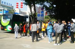 Shenzhen, China: a group of male and female workers preparing for occupational health checks at the gate of the health and epidemi. A group of workers preparing Royalty Free Stock Photo