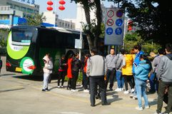 Shenzhen, China: a group of male and female workers preparing for occupational health checks at the gate of the health and epidemi. A group of workers preparing Royalty Free Stock Images