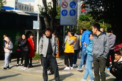 Shenzhen, China: a group of male and female workers preparing for occupational health checks at the gate of the health and epidemi. A group of workers preparing Stock Image