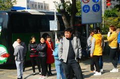 Shenzhen, China: a group of male and female workers preparing for occupational health checks at the gate of the health and epidemi. A group of workers preparing Royalty Free Stock Image