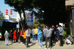 Shenzhen, China: a group of male and female workers preparing for occupational health checks at the gate of the health and epidemi. A group of workers preparing Stock Photos