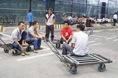 Shenzhen, China: handling goods workers Stock Images